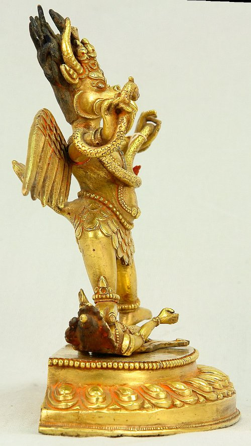 Garuda tramples on a Naga.