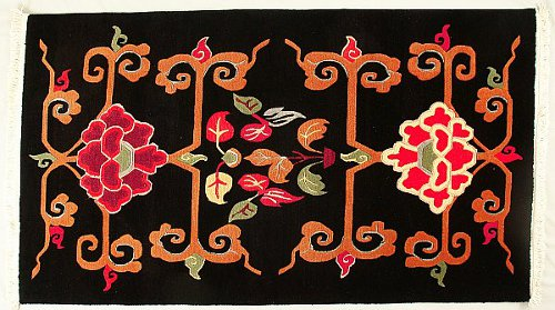 Tibetan carpet with Lotus design.